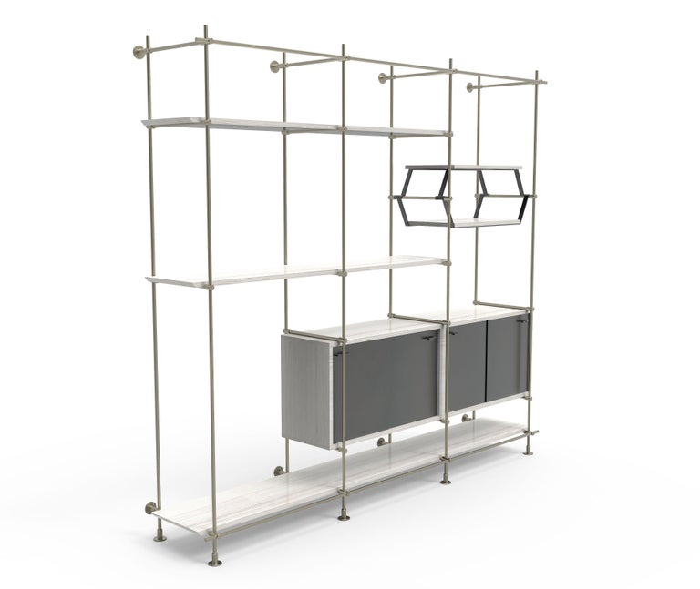 This 3 bay version of Amuneal's Collector's shelving unit features solid machined brass fittings and posts in a champagne brass finish. The unit mounts to the floor and to the wall to support a series of shelves and credenza cabinets. The wood
