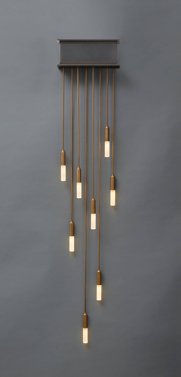 Our Amuneal designed drop light sconce combines precision machined components with a hand-applied finish to offer a clean and dramatic design for any space. This modern light is fabricated in our Philadelphia-based furniture studio and is
