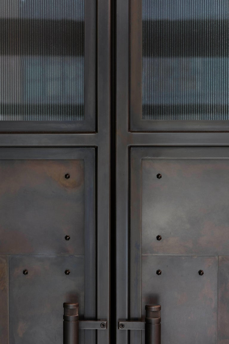 The Frankford Panel Pantry is part of our Frankford Panel system. These versatile cabinets bring strength and character to any space with their oversized blackened steel and glass doors and framework. The interior of each cabinet offers