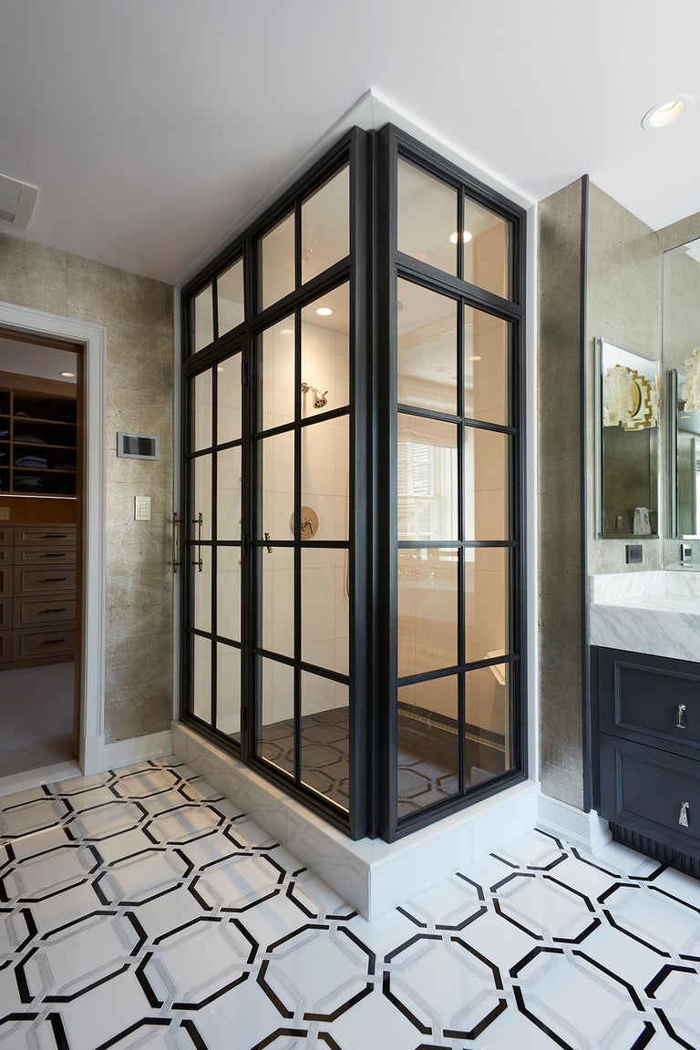 Inspired by vintage factory windows and our Frankford Panel System, this industrial custom shower enclosure includes operable transom and custom machined bronze door pulls.  The base material is stainless steel to eliminate the possibility of
