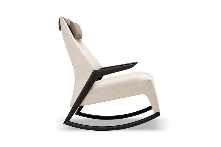 How do you renew the tradition of the rocking chair with a contemporary approach? The Coccolo armchair does this by playing with chromatic juxtaposition and the desire to enhance them.