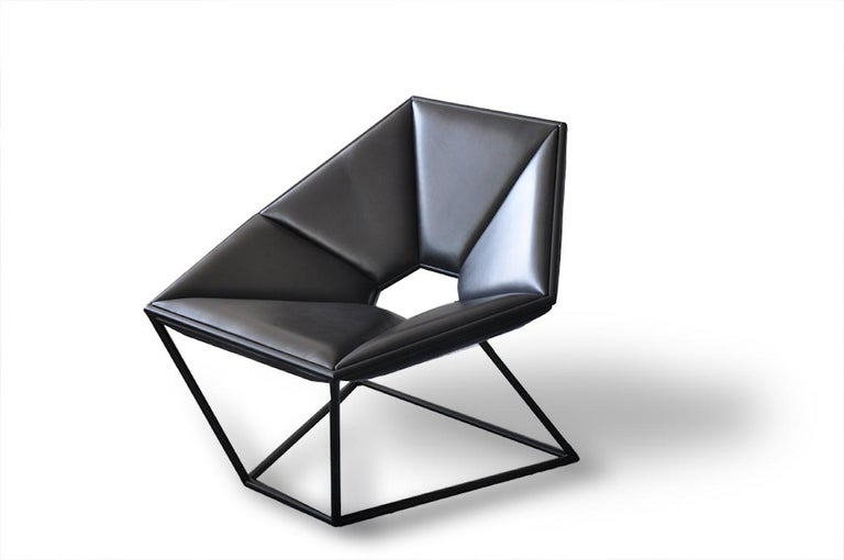 The Hexa chair adds dimension to any space. While unique in shape and design, it's a piece that refuses to clash with its surroundings. Materials include a metal frame, with wood and upholstered in leather. Designed by Antonio Pio Saracino.