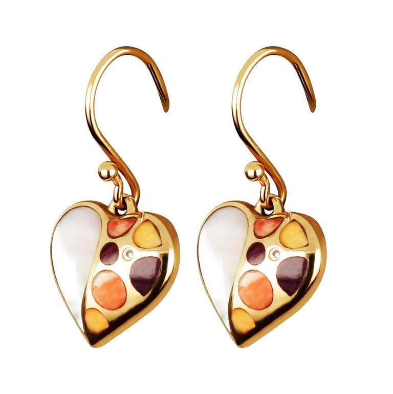 Contemporary 18 karat rose gold earrings featuring perfectly proportioned heart shapes that lead the eye to the exquisite coral and ruby stones, brought to life in blazing mother of pearls. 18 Karat Rose Gold Weight: 2.74 g