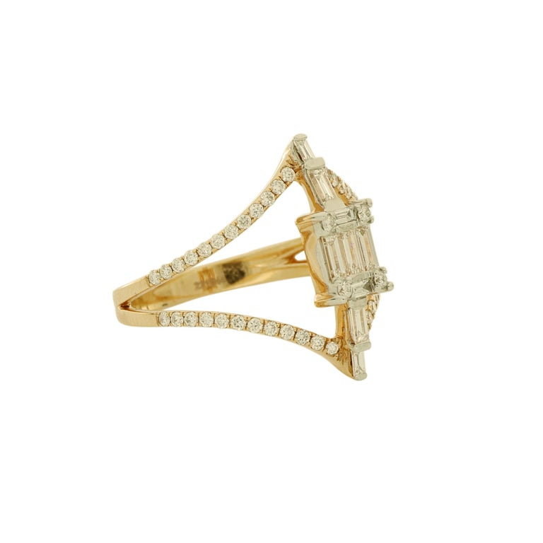 The 18 karat rose gold ring features 2 layers of round cut diamond grouped by a centerpiece baguette cut diamonds that is delicately crafted to represent strong personality, unique taste and perfect balance of glamour and elegance. It complements