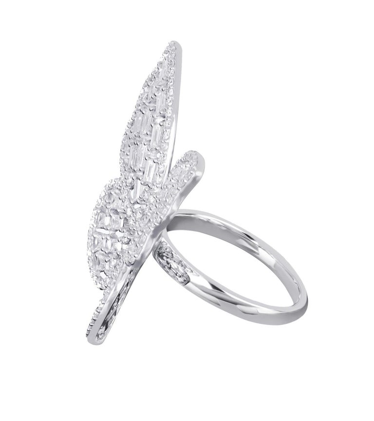 Amwaj butterfly ring in 18 karat white gold features multi layers of butterfly wings illuminated with baguette and round diamonds that presents an elegant design for every day, round diamonds trace the outline of this mesmerizing creature, with the