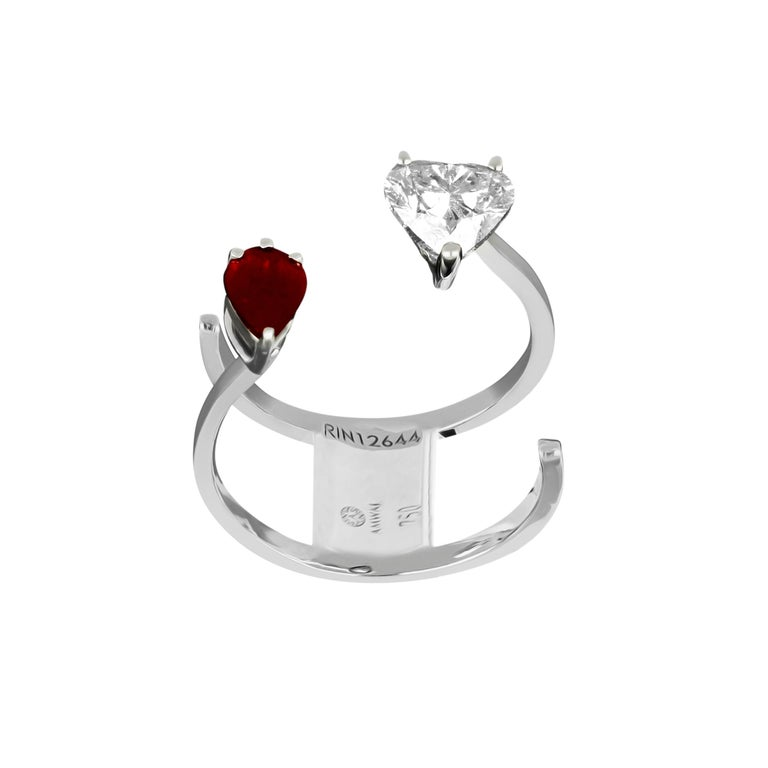 A Classic Beauty, this 18 karat white gold ring by Amwaj jewellery presents the lovers' promise of a future together featuring heart shape diamond that sit ever so beautifully and is enhanced by the pear ruby. Diamonds (Total Carat Weight: 0.91 ct)