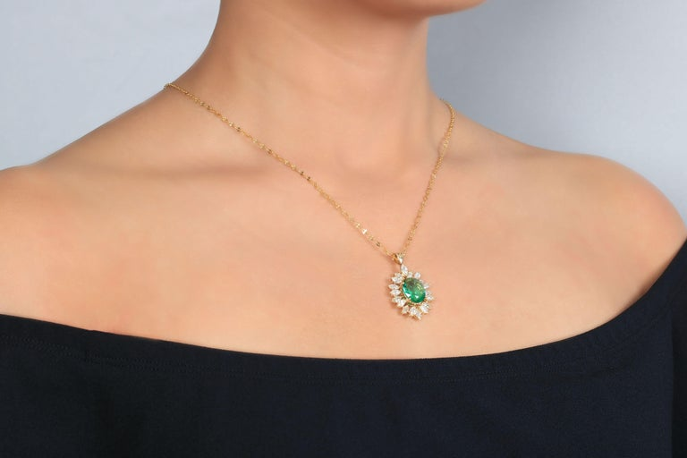 A Golden Glow, this oval cut Zambian emerald with marquise cut diamonds necklace creates a sense of delight mixed with this artistic combination of precious stones. Although it's a classic emerald jewelry, it holds the appeal of a modern