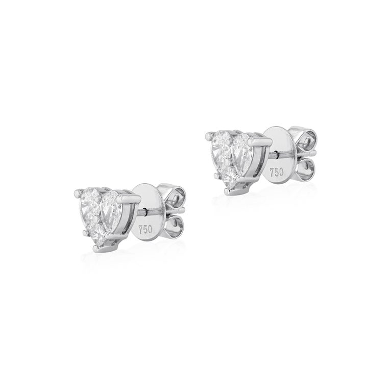 Eternally enchanting, the 18 karat white gold heart shape diamond stud earrings are born from timeless design, featuring the finest quality diamonds, each meticulously cut by our master craftsmen to ensure perfect symmetry and proportion making it a