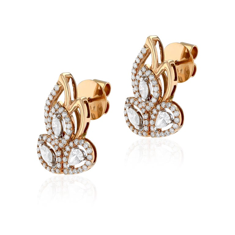 Combining exceptional artistry with extraordinary craftsmanship, our inspired by leaves earrings feature round, pear and marquise cut diamonds, set to form swirls of glance. Suspended from each are three beautifully articulated slices of pear and