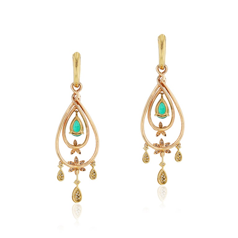 A charming display of color and brilliance, these sensational 18 karat rose gold chandelier earrings by Amwaj Jewelry exult the beauty of 4.03 carats round cut white diamonds, set with 3.49 ct pear shape emerald to optimise their uniquely