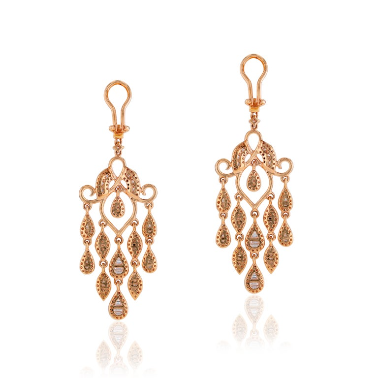 The sleek lines and striking color of 3.77 carats of white diamonds is showcased in these luxurious chandelier rose gold earrings by Amwaj Jewelry. Suspended from each piece, five articulated rows of round and baguette cut white diamonds.  Diamonds