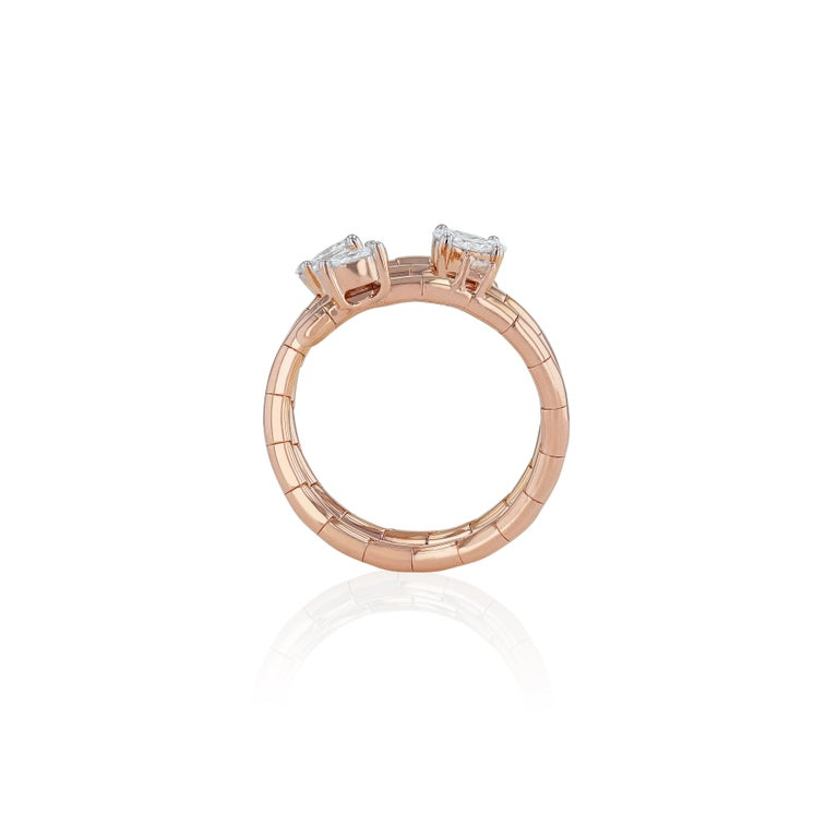 A contemporary design celebrating our imaginative masterpieces, placing 6 small to medium round exquisite round diamonds either side of the finger, arranged into potent layers of rose gold.  Diamond Clarity: VS SI / G H COLOR  Diamonds (Total Carat
