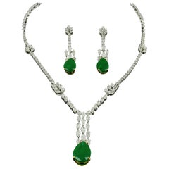Amwaj White Gold 18 Karat Necklace and Earrings with Diamonds and Emeralds
