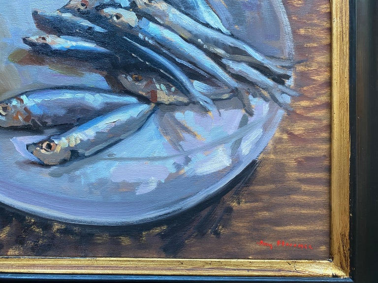 An oil painting of sardines on a round white plate. Painted from direct observation, using classical academic painting methods. Small colorful brushstrokes make up scaly metallic fishes, which glisten atop a simple white plate.   Framed in a