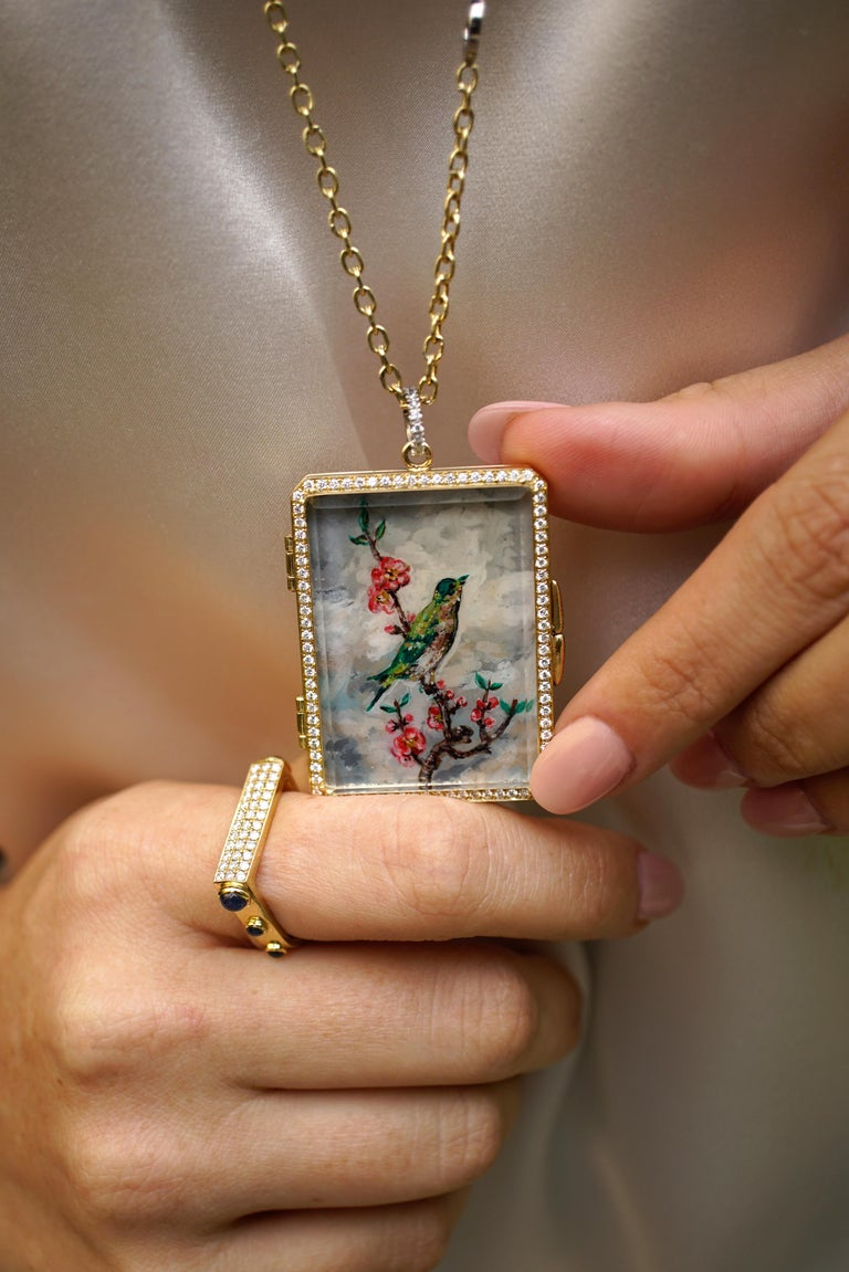Amy Y's 18K-yellow gold, platinum, diamond, 30.00ct. Citrine and painted enamel  'Bird Locket' pendant necklace Olivia is exquisitely designed to capture the essence of the bird kingdom in its natural environment.  Designed from the heart, this