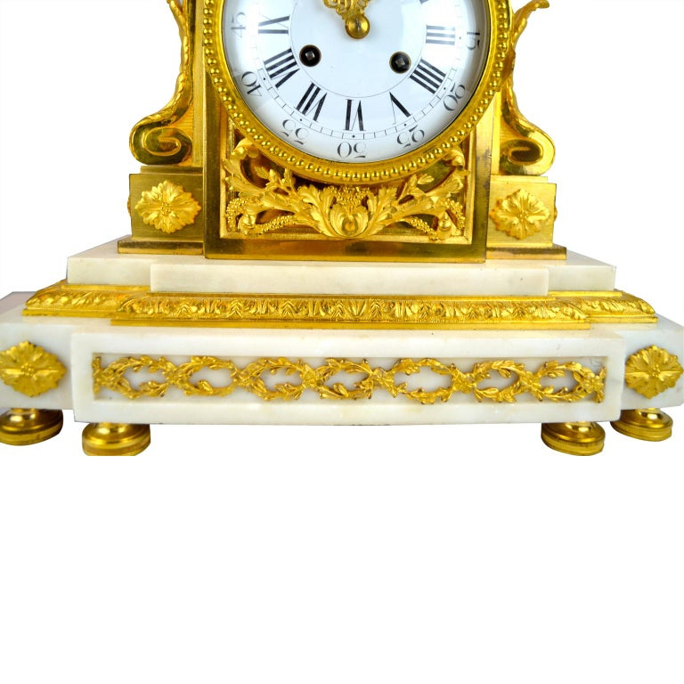 Hand-Carved 18th Century French Louis XVI White Marble and Gilt Bronze Architectural Clock For Sale