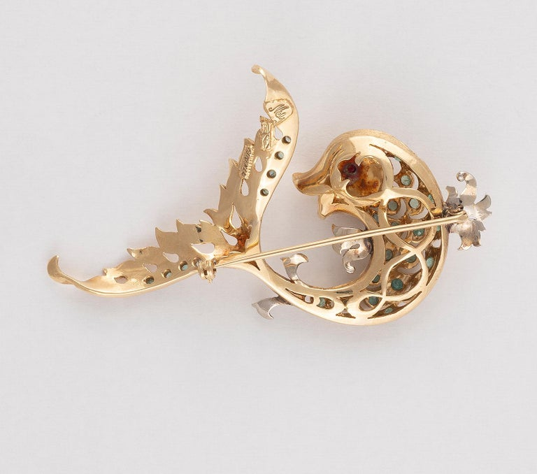 Emerald Cut 18 Carat Gold Emerald and Ruby Dolphin Brooch For Sale