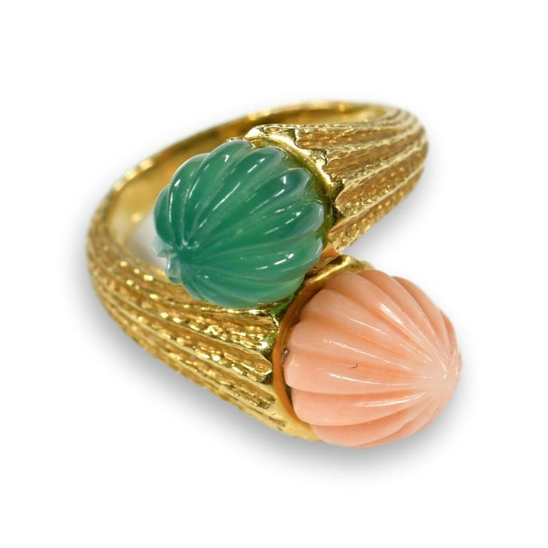 An Exquisite coral and Chalcedony ring are nestled together to create Toi et Moi ring. The French call this shape