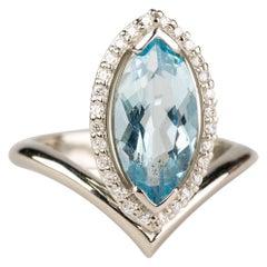 18 Karat White Gold, 2.29 Carat Marquise Aquamarine Ring with a Diamond Halo