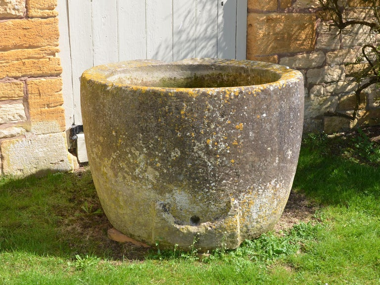 An 18th century circular stone trough with good weathering and patination.