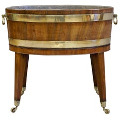 An 18th Century George III Oval Mahogany and Brass Bound Wine cooler