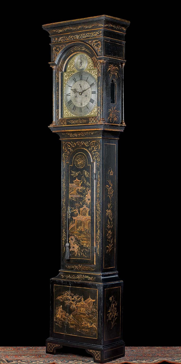 A fine oak longcase clock by Philip Avenell of Farnham with later lacquered chinoiserie decoration. The eight day movement strikes the hours on a clear bell. The clock face has a 12 inch brass break arched brass dial flanked by ornate gilt brass