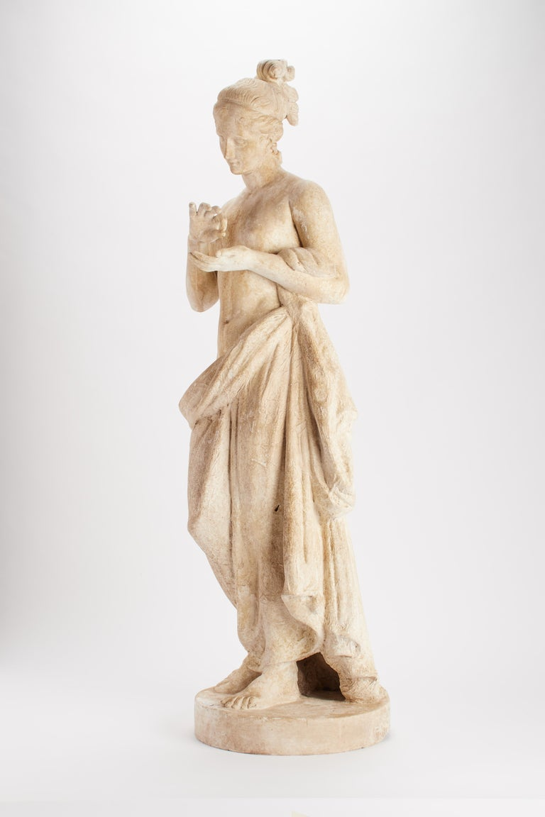 Over the plaster round base is set the cast of a sculpture of a Psyche. Plaster cast for drawing teaching in Academy. Made out of plaster and painted paper mâché, Italy, circa 1890.