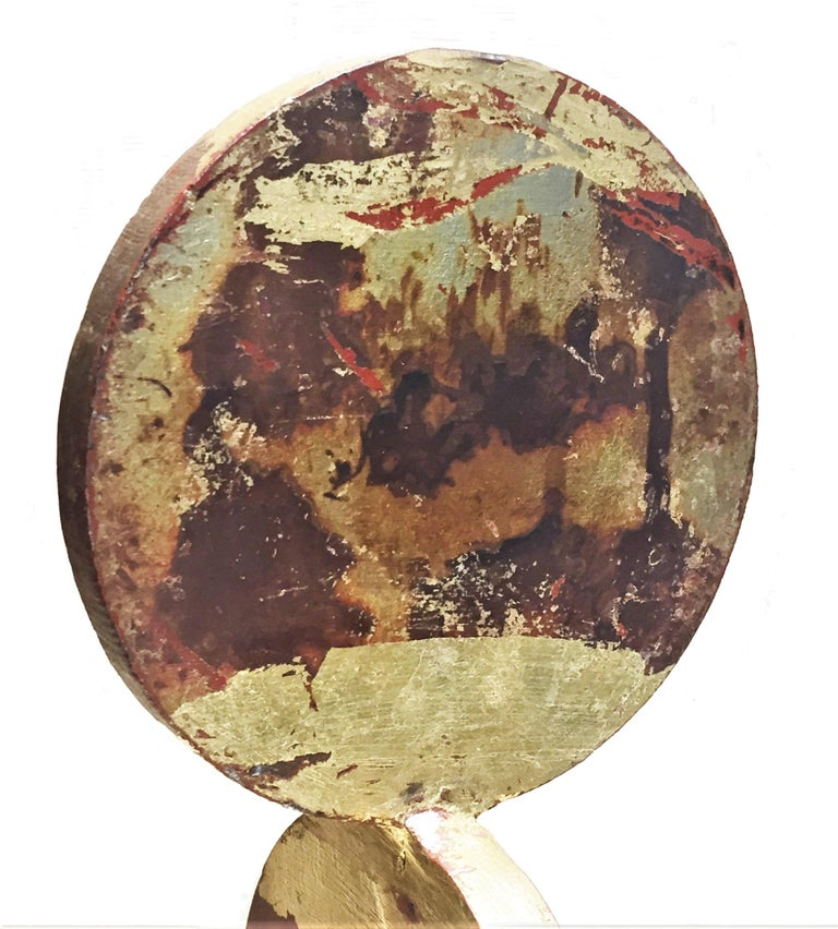 """Illegibly signed by the artist on the base, this laconic in form anodized iron sculpture's rough and brutal surface is further enhanced with only a few segments of circles painted with a real gold paint.   Dimensions: Height 14.75"""", width 4.75"""""""