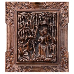 Ancient Carving of Exotic Wood Representing Two Lovers Hidden Among the Trees