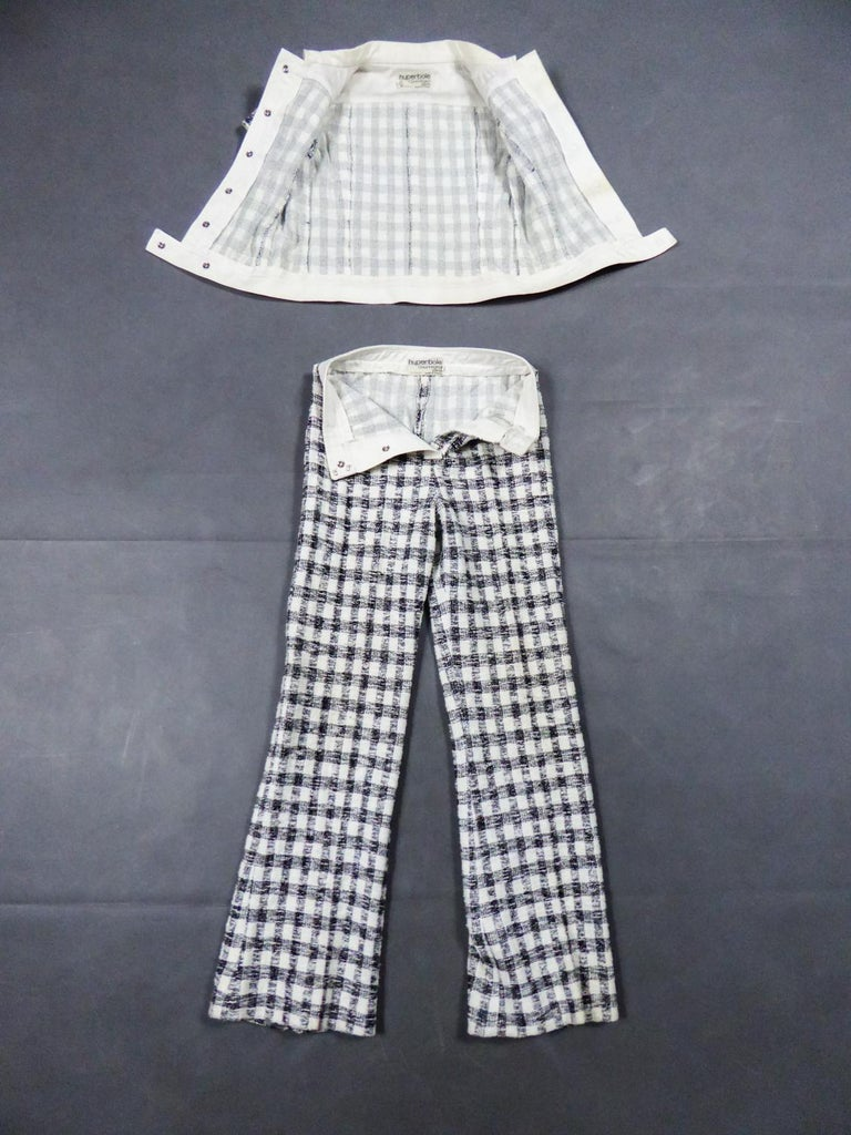 Circa 1969 France Haute Couture  A pant suit by André Courrèges Hyperbole Size O from the late 1960s. Wool knitting and stretch cotton with boucléwoven with black checkedon a white background, reminiscent of Vichy motifs or inspired by the