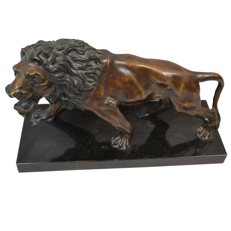 A late 19th century cast bronze of a growling lion in dark brown patinated bronze; unsigned and mounted on a rectangular black marble base.