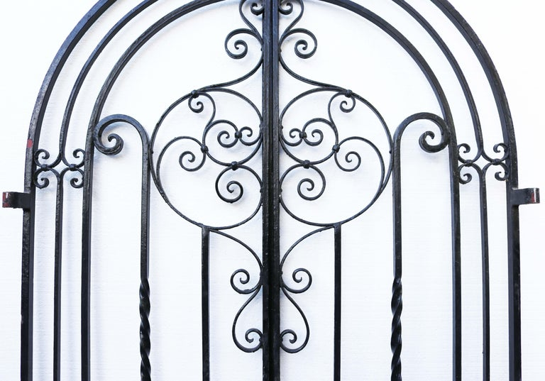 An attractive arched wrought iron gate, the lower part decorated with scroll work. This gate was salvaged from a property in Essex.     Condition report  Good structural condition. Working gate stay present, all hinge eyes present. No key