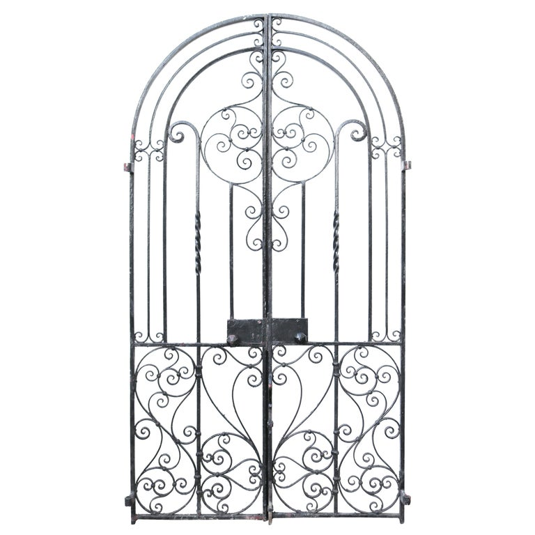 An Antique Arched Wrought Iron Garden Gate For Sale