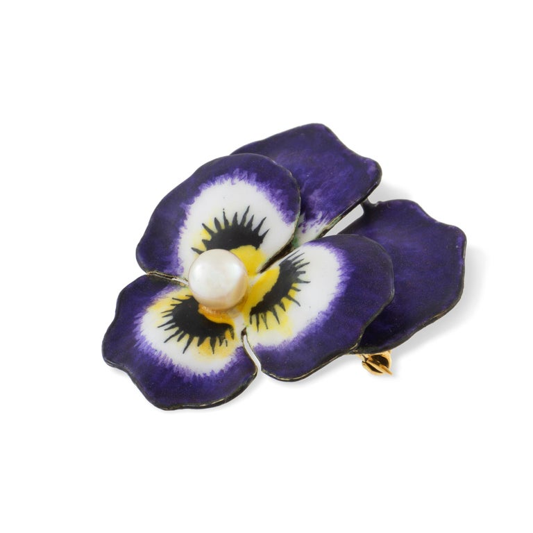 An antique enamel and pearl pansy brooch, the round pearl measuring approximately 5mm set to the centre of five realistically carved and enamelled petals with a yellow gold back with brooch fitting, stamped 14K, made in the USA circa 1900, measuring