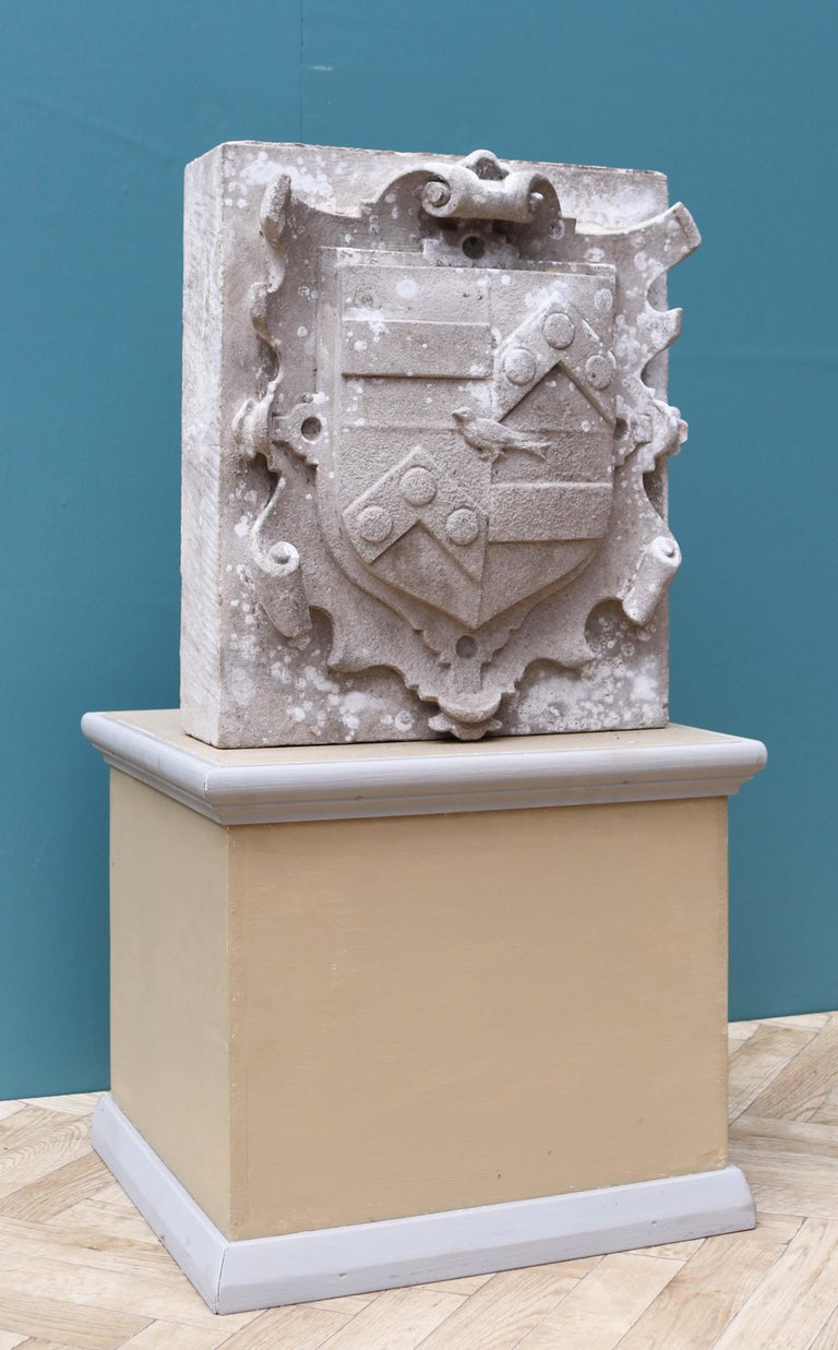 An armorial panel, hand carved from natural limestone. From Athelhampton House, one of England's finest Tudor Manor Houses. Dating from 1485.