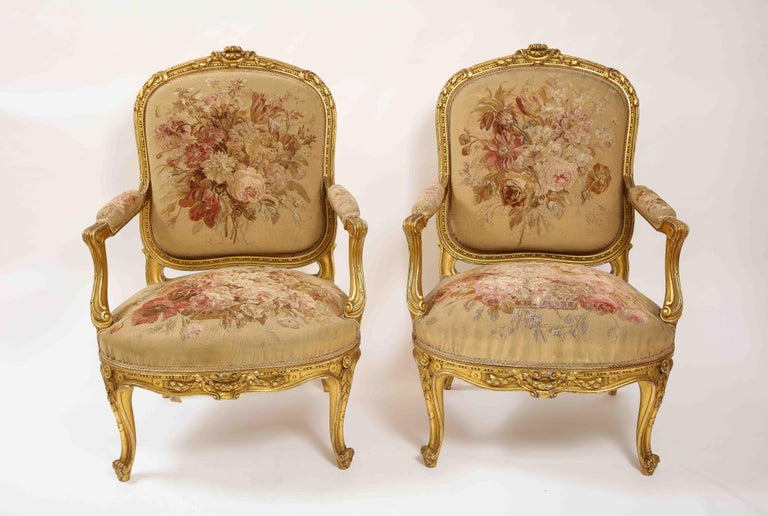 An Antique French 19th Century Louis XVI Style Five Piece Royal Giltwood and Aubusson Complete Suite with Canapé and four side-chairs, Attributed to Linke. This suite comprises of a canapé and four side-chairs. Each piece is made up of