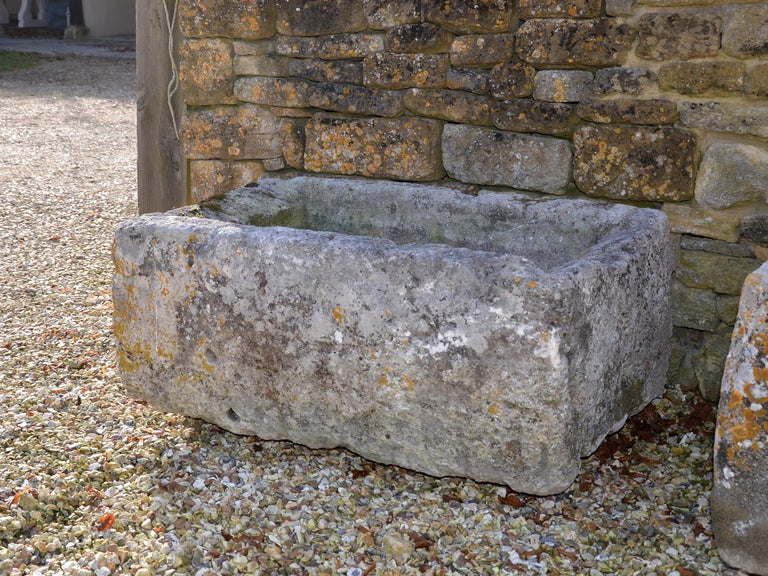 Antique limestone trough with good weathering and patination.