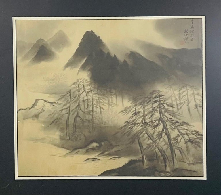 """An antique Sumi ink ( Sumi-e) Japanese painting featuring a landscape scene of mountains and beautifully made on silk. The painting is matted and framed.  The Japanese term """"sumi"""" means """"black ink"""", """"e"""" means """"painting"""". It indicates one of the"""
