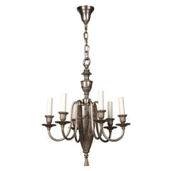 An antiqued nickel chandelier by Bradley and Hubbard
