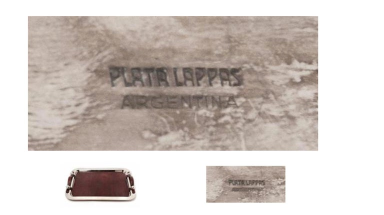 An Argentine silver plate and leather serving tray  Plata Lappas, Buenos Aires, 20th century  the tray with a spot-hammered finish.  marked 'Plata Lappas/ Argentina' to the underside  Width of tray 26 3/4 inches.