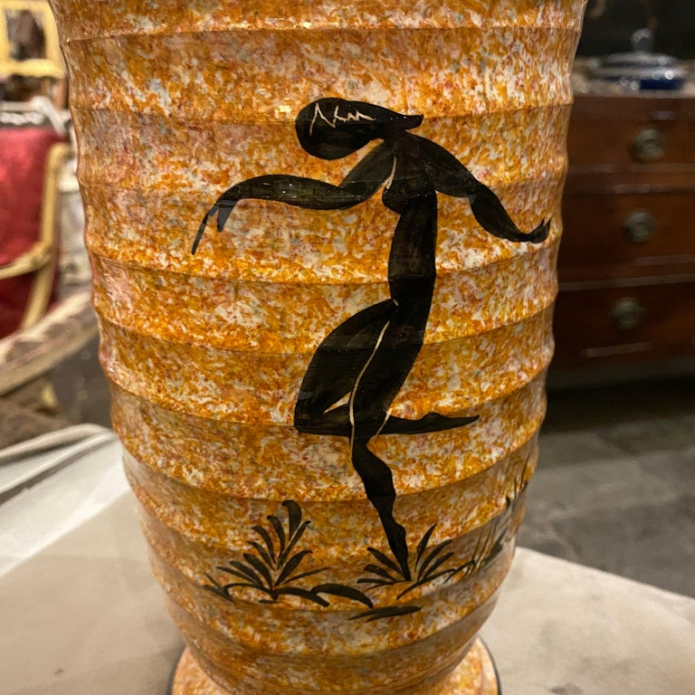 An Art Deco vase made in the small town of Albisola famous in that period for Futurist ceramic items. The orange vase is decorated with a dancer.