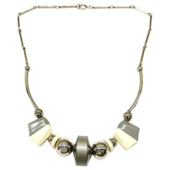 An Art Deco grey and cream Bakelite, chrome metal necklace, Germany, 1930s
