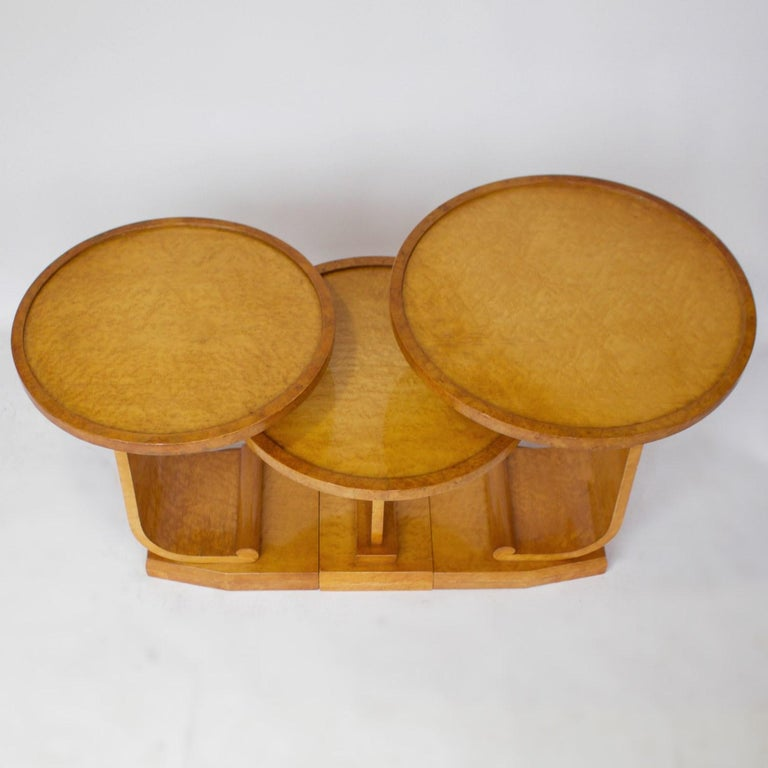 An Art Deco nest of tables. Three interlocking side tables with bird's-eye maple and burr walnut veneers. 