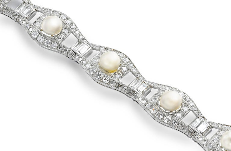 An Art Deco pearl and diamond bracelet, with a pearl to the centre of each link, stating the bracelet to have eight natural pearls and one cultured pearl, surrounded by a lozenge shape eight- and old brilliant-cut diamonds and a baguette-cut