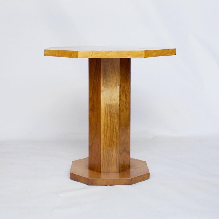 An Art Deco side table with a bird's-eye maple tabletop and base connected by a burr walnut octagonal stem.   Dimensions: H 98cm W 48cm W/D 46cm base W/D 36cm  Origin: English  Date: circa 1930  Item Number: 2907202  All of our furniture is