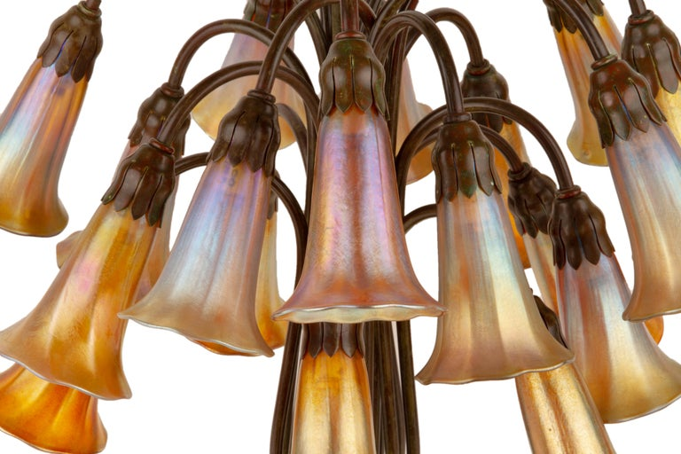An American Art Nouveau patinated bronze and favrile