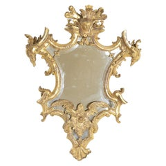 Baroque Italian Mid-18th Century Gilt Mirror with Faces