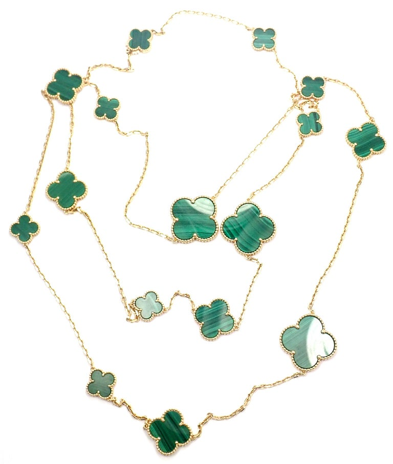 18k Yellow Gold Magic Malachite Alhambra Necklace by Van Cleef & Arpels. With 3 Large Malachite stones: 26mm x 26mm 5 Medium Malachite Stones: 20mm x 20mm 8 Small Malachite Stones: 15mm x 15mm This necklace comes with Van Cleef & Arpels certificate