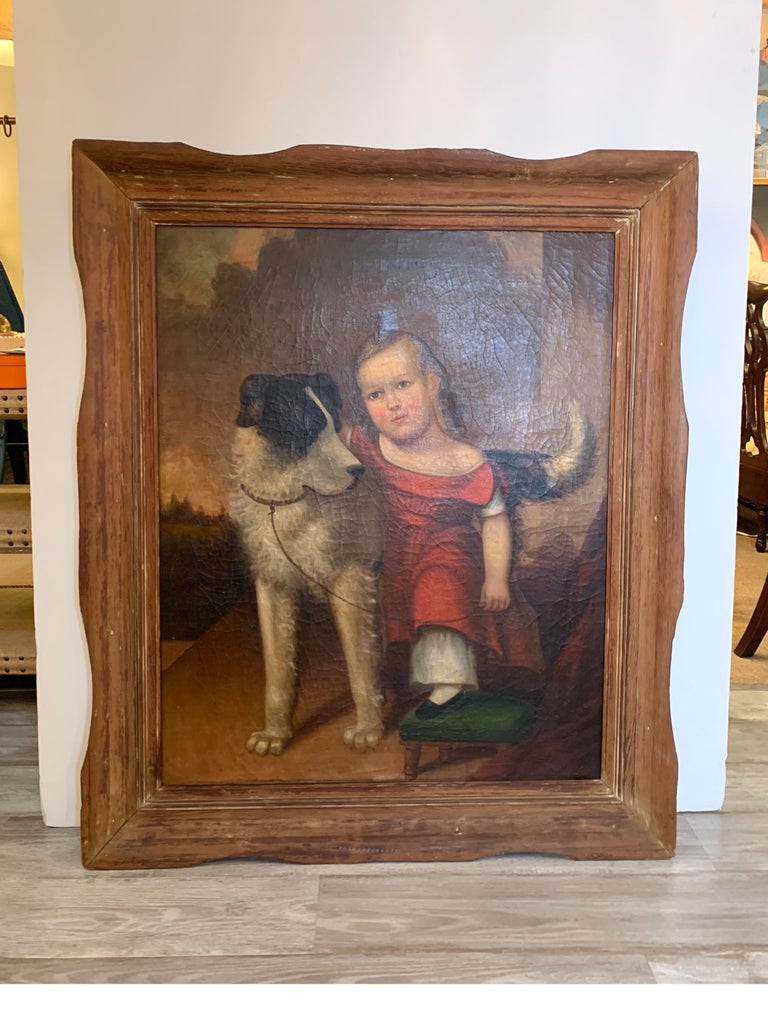 An early 19th century oil painting of a child with dog, possibly a collie. The child in red clothing with a small green stool with arm around beloved dog.