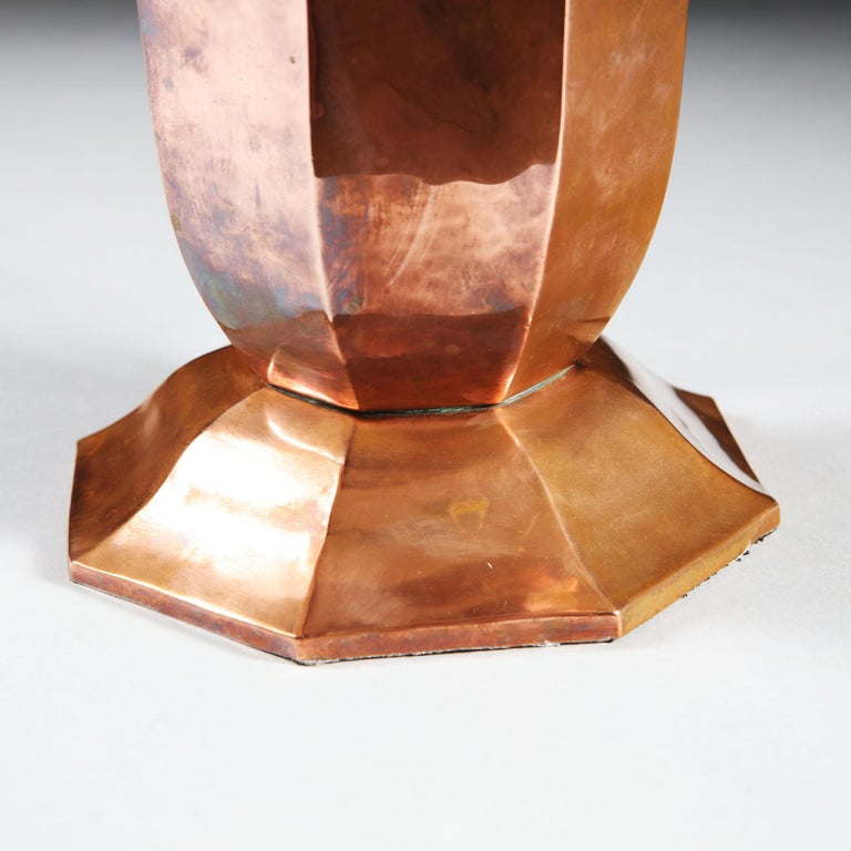 An early 20th century French copper vase of octagonal form, with a flared neck and raised base, now mounted as a table lamp.